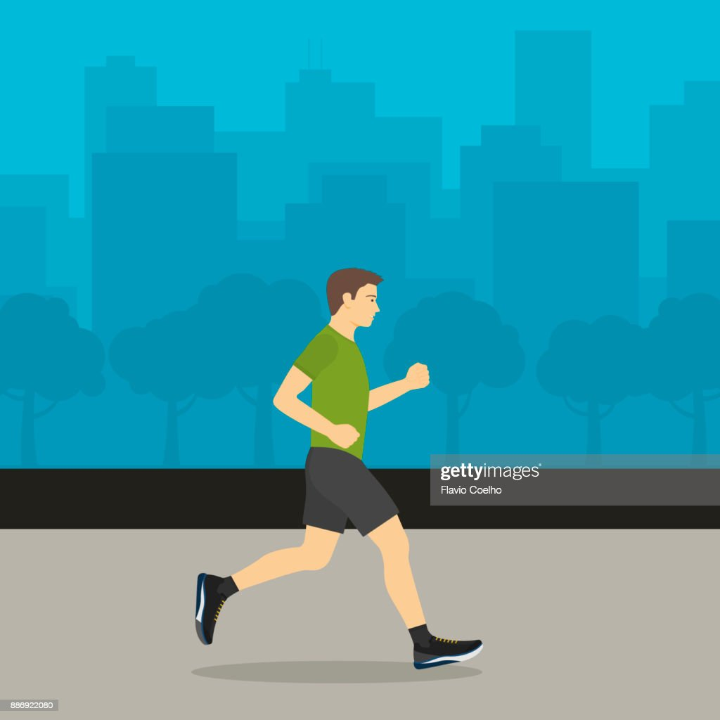Young man jogging with cityscape on the background : Stock Photo