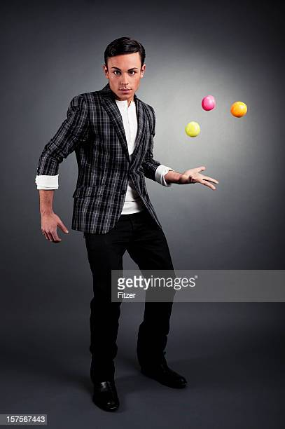 young man juggling with style