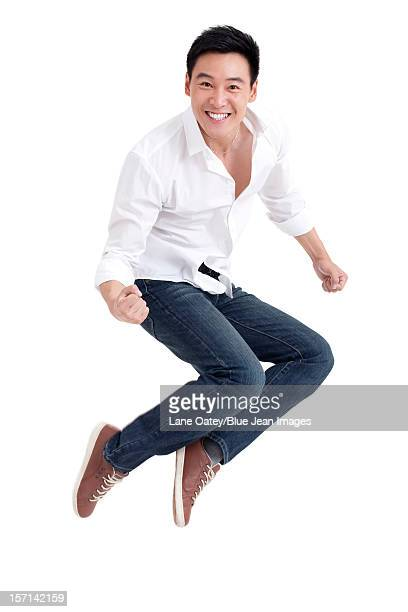 Young man jumping in mid air