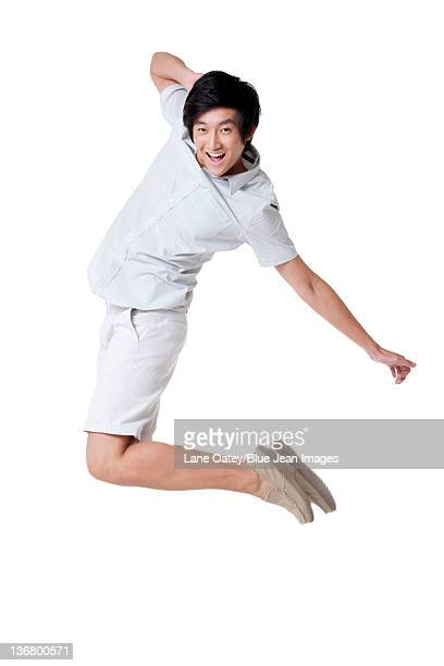 Young Man Jumping In the Air