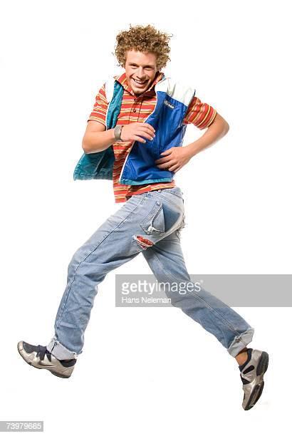 Young man jumping into air