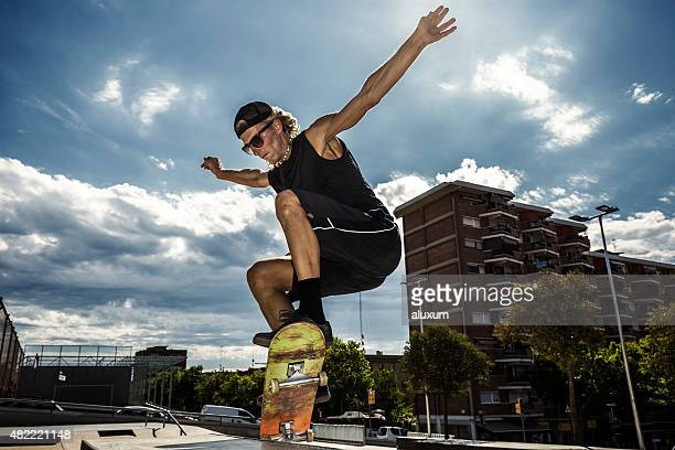 young man jumping on skateboard - ollie pictures stock pictures, royalty-free photos & images
