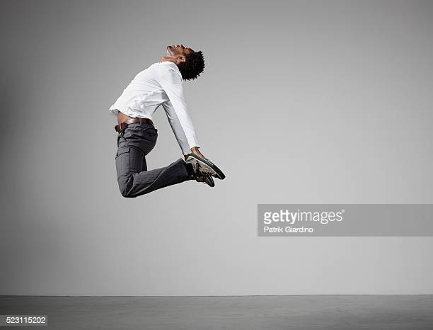 young man jumping - mid air stock pictures, royalty-free photos & images