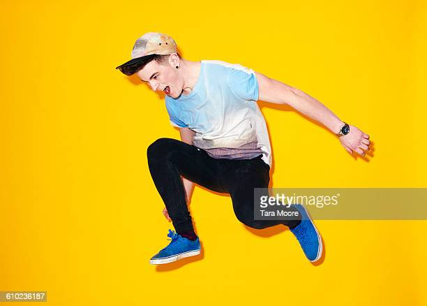 young man jumping - street style stock pictures, royalty-free photos & images