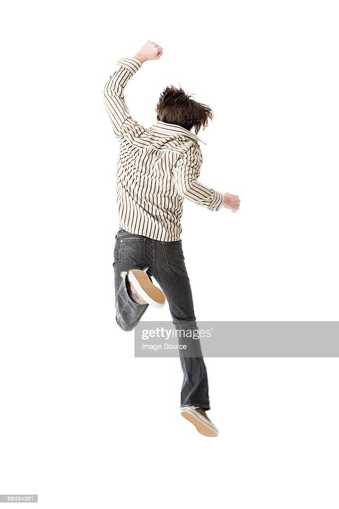 Young man jumping : Foto de stock