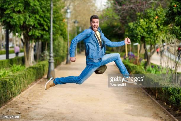 young man jumping - ダブルデニム ストックフォトと画像