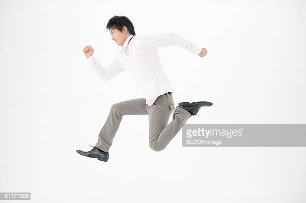 Young man jumping, studio shot