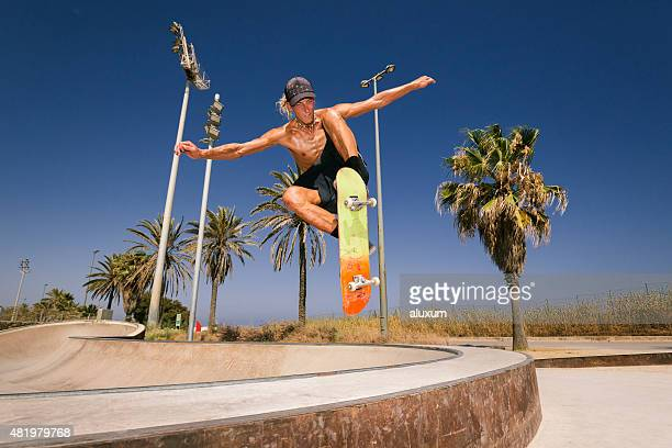 young man jumping with skateboard - ollie pictures stock pictures, royalty-free photos & images