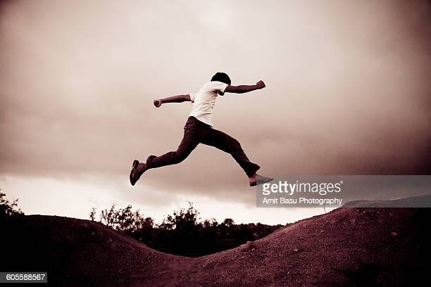 Young man jumps across gap