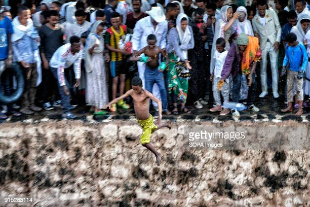 A young man jumps into the waters of the Fasilides Baths The annual Timkat festival an Orthodox Christian celebration of Epiphany remembers the...