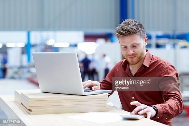 Young man keeping track of all the stock