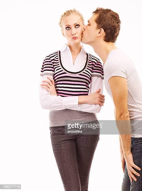 Young man kissing beautiful woman