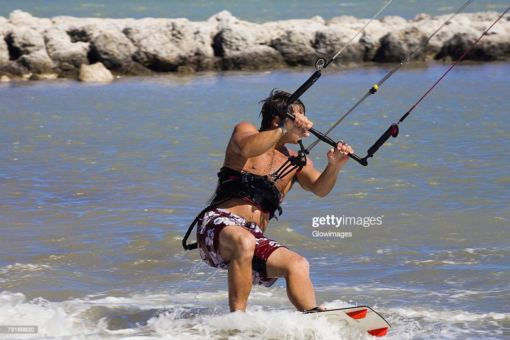 Young man kite boarding in the sea, Smathers Beach, Key West, Florida, USA : Stock Photo