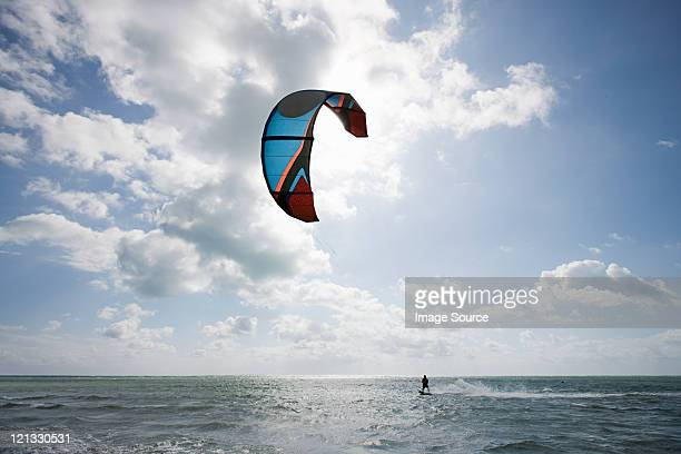 young man kitesurfing - kiteboarding stock photos and pictures