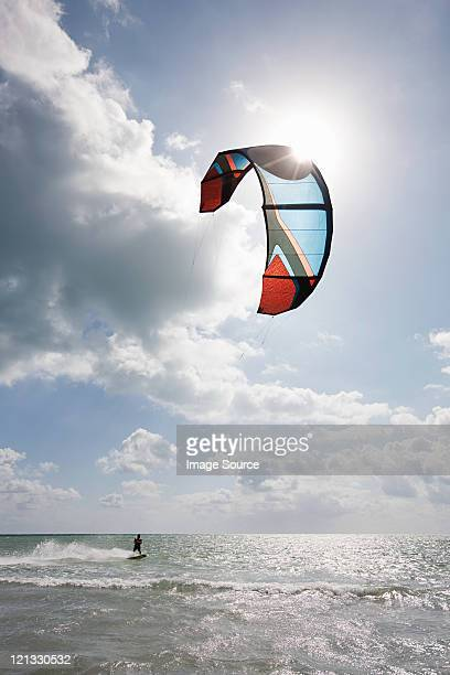 Young man kitesurfing