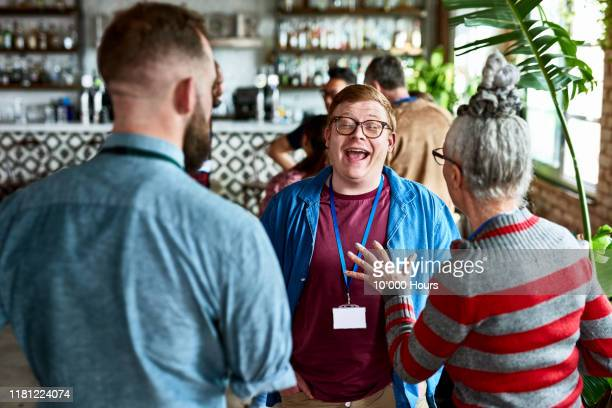 young man laughing and enjoying after work drinks - humour stock pictures, royalty-free photos & images