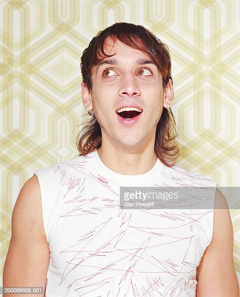 young man laughing, mouth open, close-up - mullet stock photos and pictures