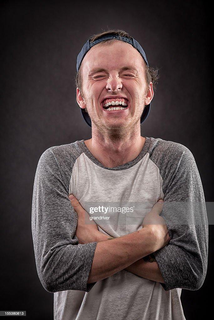 笑う若い男性 : ストックフォト