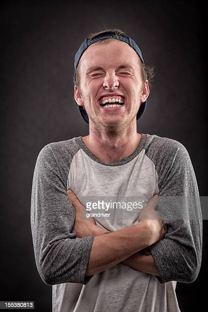 young man laughing - hysteria stock pictures, royalty-free photos & images