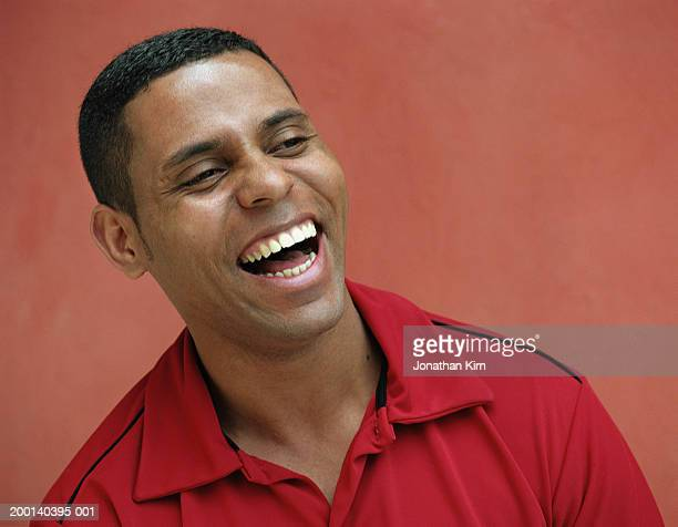 young man laughing - brazilian ethnicity stock pictures, royalty-free photos & images