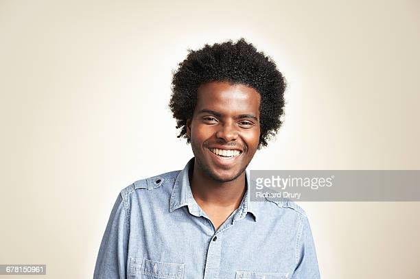 young man laughing - part of a series stock pictures, royalty-free photos & images