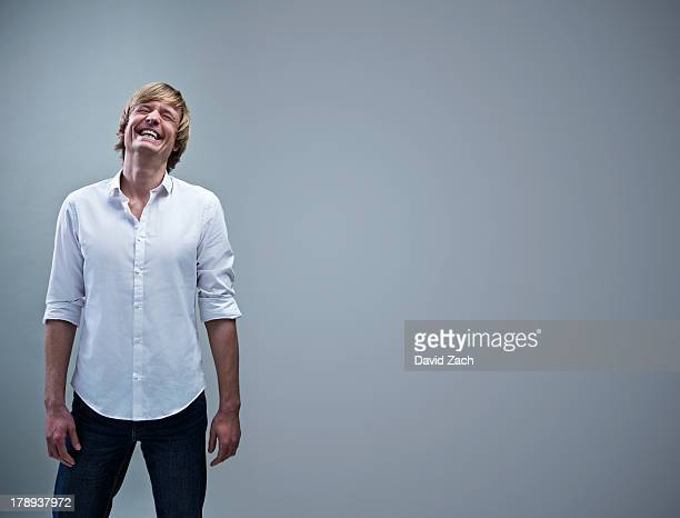 young man laughing, portrait - rolled up sleeves stock pictures, royalty-free photos & images