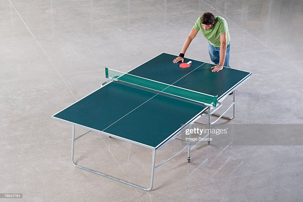 Young man leaning on a table tennis table : Stock Photo