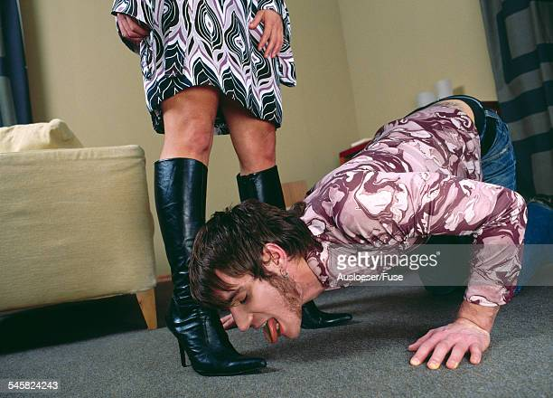 young man licking womans boots - foot fetishes stock pictures, royalty-free photos & images
