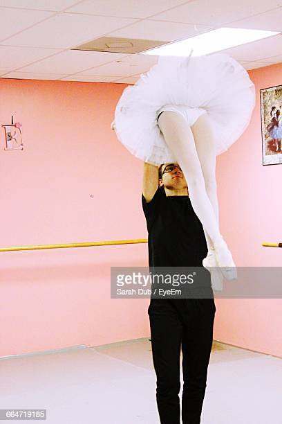 young man lifting ballerina at studio - sarah hardy stock pictures, royalty-free photos & images