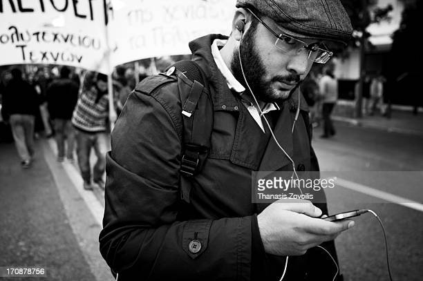Young man listening music in the demonstration for the 39th anniversary of the Athens Polytechnic.