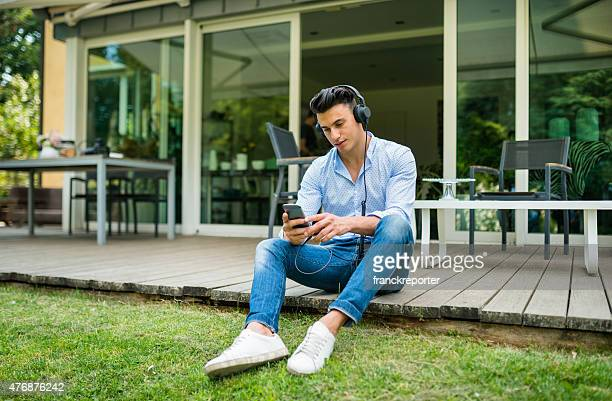 young man listening music with headphone