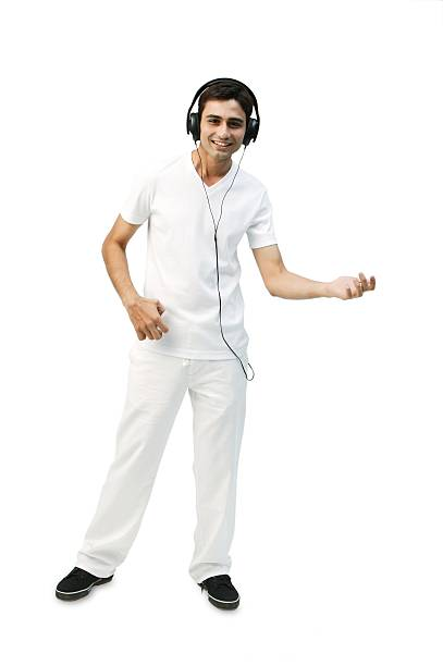 Young man listening to headphones, playing air guitar