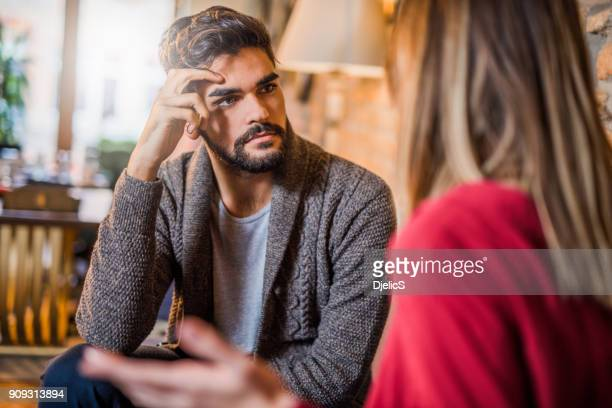 Young man listening to his girlfriend about her problems.