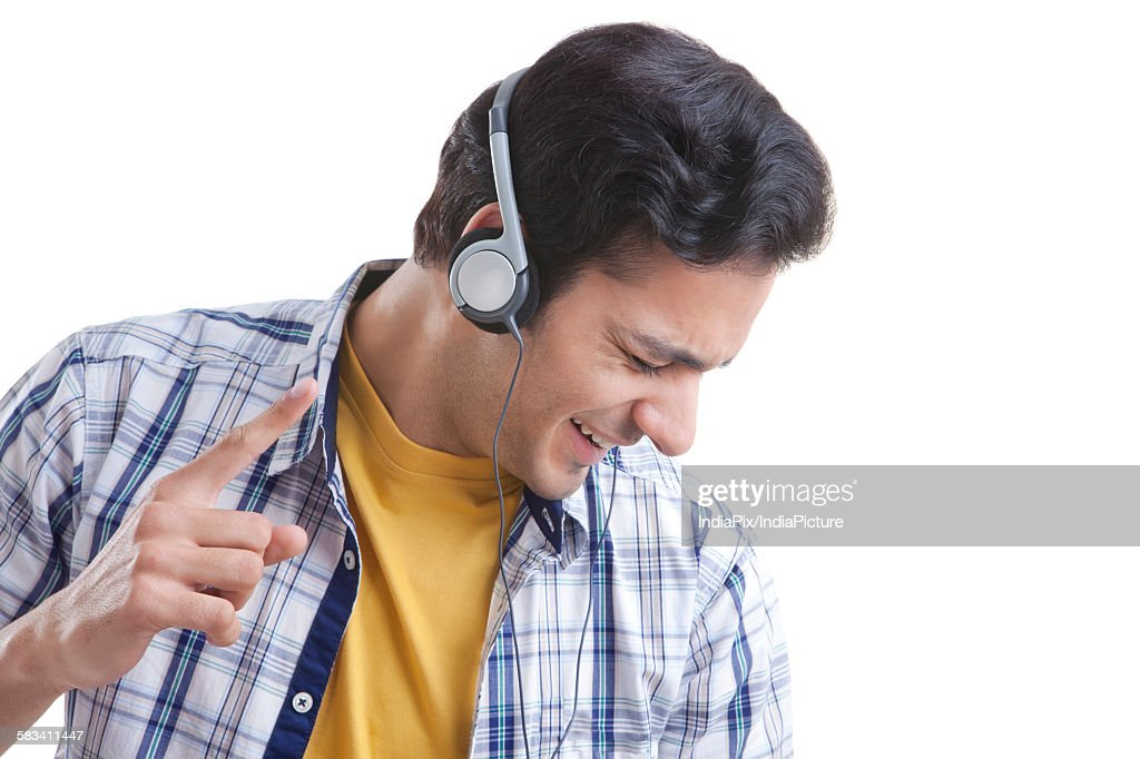 Young man listening to music : Stock Photo