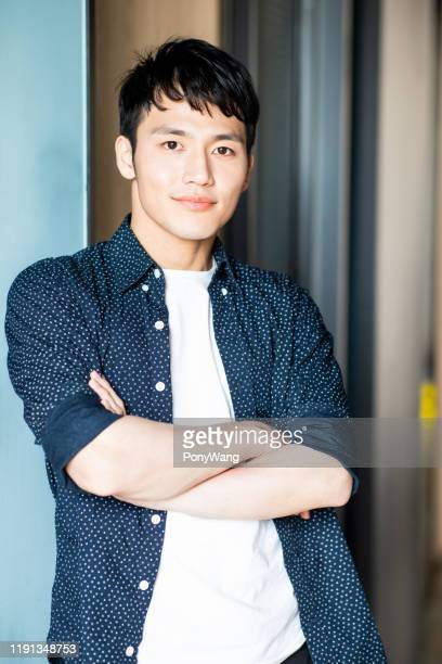 young man look to you - korean ethnicity stock pictures, royalty-free photos & images