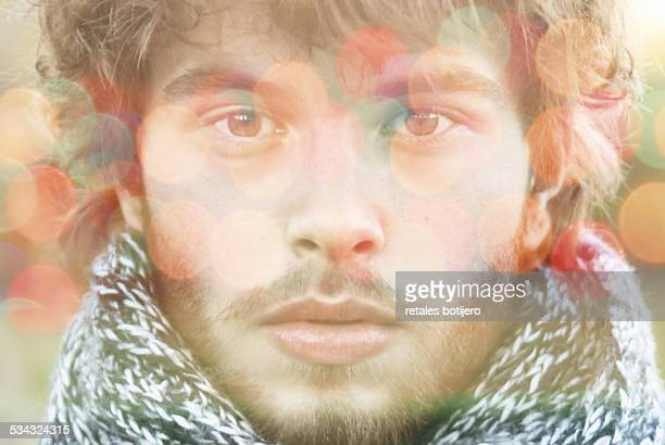young man looking at camera - snood headwear stock photos and pictures