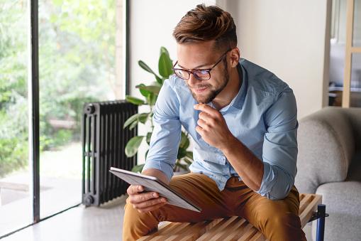 Young Man looking at digital tablet 1184382530