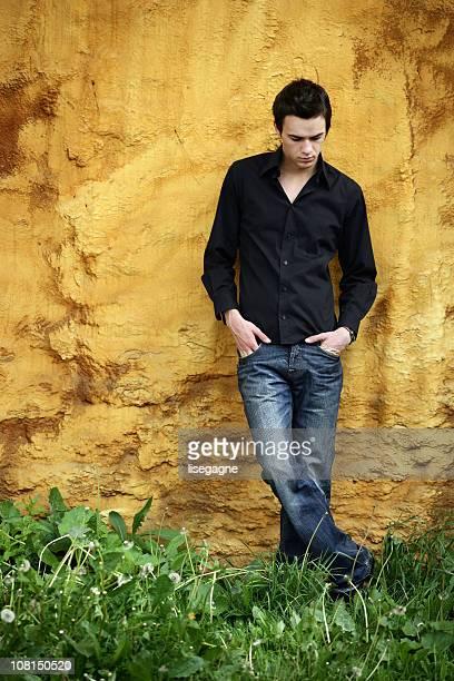Young Man Looking at Feet
