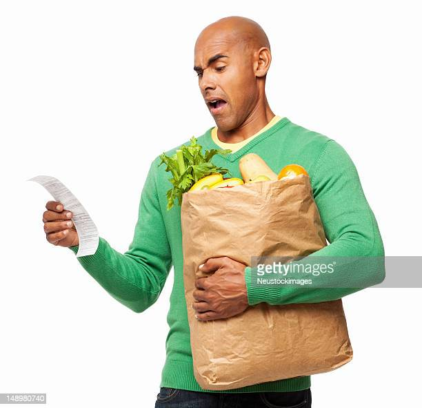 Young Man Looking At Groceries Bill - Isolated