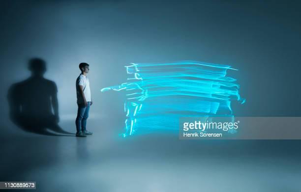young man looking at lightrace person - lichtspur stock-fotos und bilder