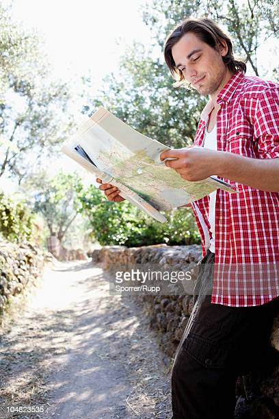 Young man looking at map