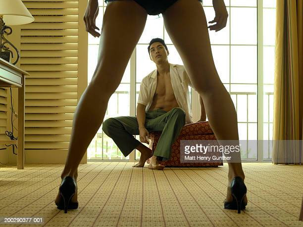 young man looking at woman in bedroom, rear view of woman, low section - legs apart stock photos and pictures