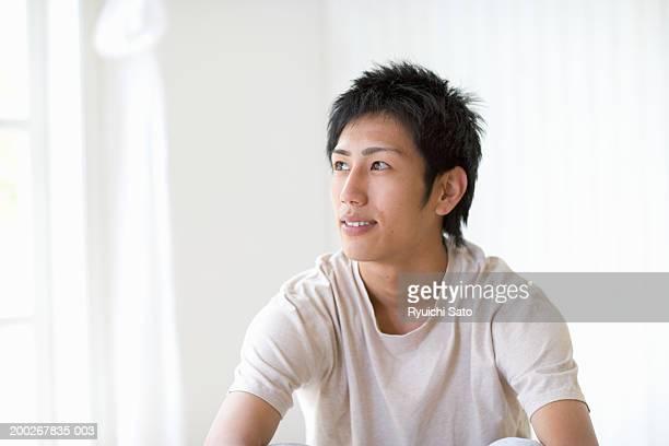 Young man looking away, close-up