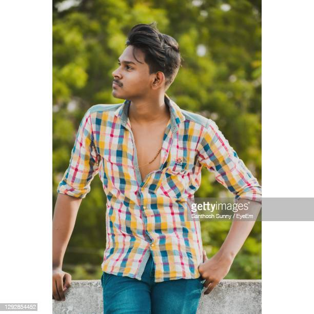 young man looking away - printed sleeve stock pictures, royalty-free photos & images