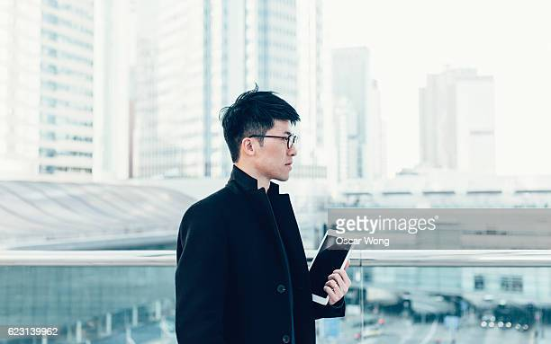 Young man looking out cityscape