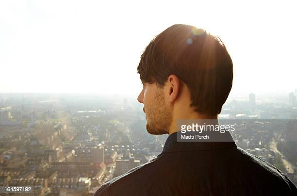 young man looking out on the city