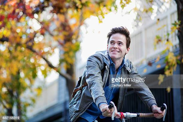 young man looking sideways whilst cycling - monrovia california stock pictures, royalty-free photos & images