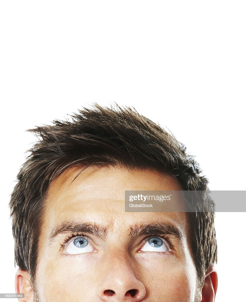 Young man looking up : Stock Photo