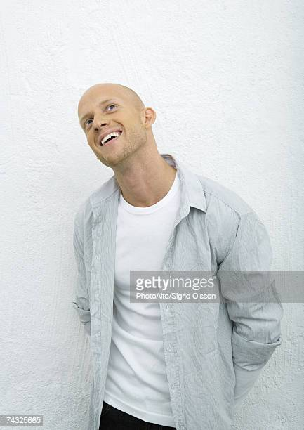 young man looking up, smiling, portrait - completely bald stock pictures, royalty-free photos & images