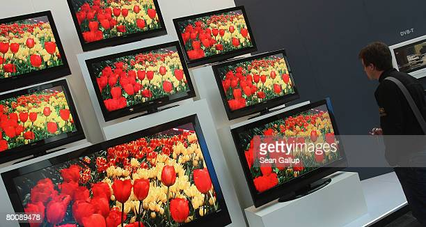 Young man looks at high definition LCD displays at the Vestel stand at the CeBIT technology fair a day before the fair's official opening on March 3,...